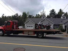 motorcycle on flatbed tow truck